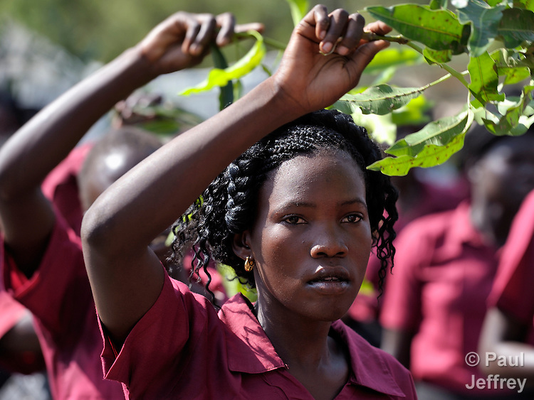 A woman waves a branch and sings as she and other Catholics participate in a procession through the streets of Juba on November 20 to pray for a peaceful January 2011 referendum on Southern Sudan's secession from the north of the country. The independence vote has widespread support throughout Southern Sudan, including among Christians. NOTE: In July 2011 Southern Sudan became the independent country of South Sudan.