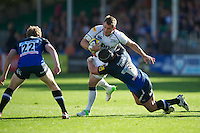 Mark Cueto of Sale Sharks is tackled by Carl Fearns of Bath Rugby as Sam Vesty of Bath Rugby looks on during the Aviva Premiership match between Bath Rugby and Sale Sharks at the Recreation Ground on Saturday 29th September 2012 (Photo by Rob Munro)