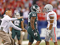 Tensions were high in the first half between *Michigan State Spartans running back Jeremy Langford (33) and Ohio State Buckeyes linebacker Ryan Shazier (2)at Lucas Oil Stadium in Indianapolis, Ohio on December 7, 2013.  (Chris Russell/Dispatch Photo)