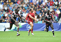 Wales's Lee Williams breaks forward before scoring his sides third try<br /> <br /> Kenya Vs Wales - men's placing 5-8 match<br /> <br /> Photographer Chris Vaughan/CameraSport<br /> <br /> 20th Commonwealth Games - Day 4 - Sunday 27th July 2014 - Rugby Sevens - Ibrox Stadium - Glasgow - UK<br /> <br /> © CameraSport - 43 Linden Ave. Countesthorpe. Leicester. England. LE8 5PG - Tel: +44 (0) 116 277 4147 - admin@camerasport.com - www.camerasport.com
