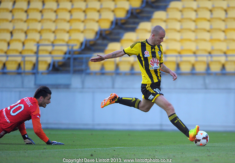 Stein Huysegems beats keeper Vedran Janjetovic to score during the A-League football match between Wellington Phoenix and Sydney FC at Westpac Stadium, Wellington, New Zealand on Sunday, 22 December 2013. Photo: Dave Lintott / lintottphoto.co.nz