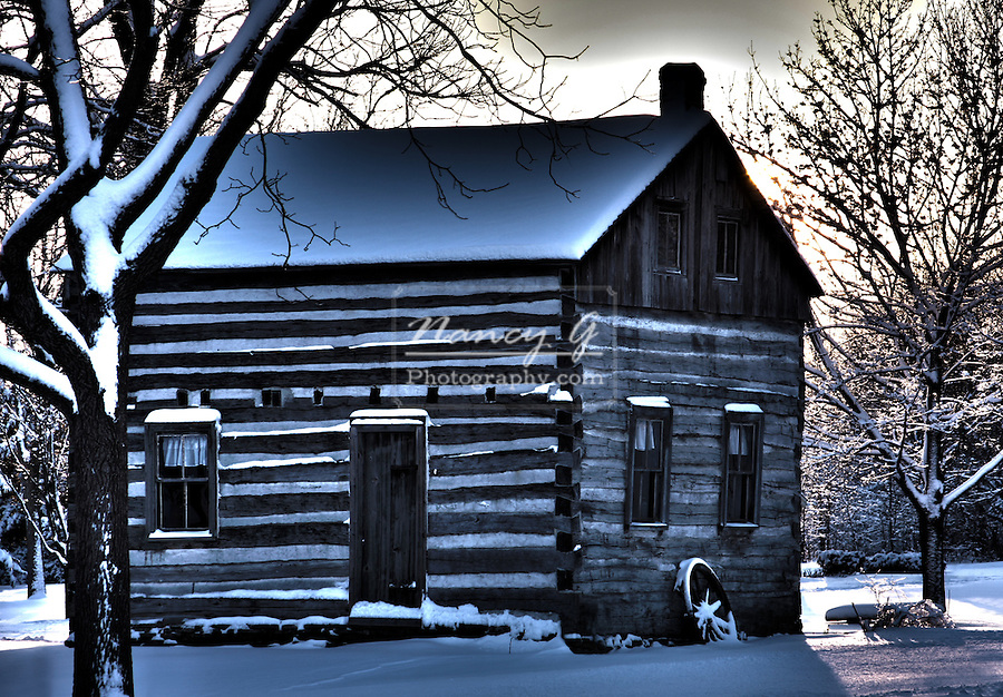 HDR image of a snow covered landscape with an 1867 log cabin in Wisconsin