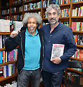 """CORAL GABLES, FL - MAY 17: Former """"Angola 3"""" inmate Albert Woodfox and Mitchell Kaplan pose for a picture after Albert sign copies of his book """"Solitary"""" at Books & Books on May 17, 2019 in Coral Gables, Florida. ( Photo by Johnny Louis / jlnphotography.com )"""