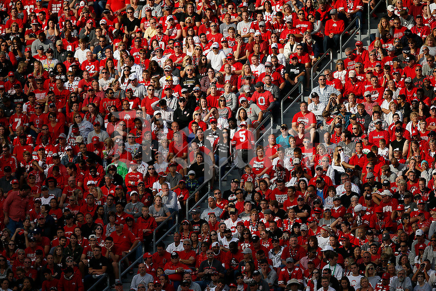 Ohio State fans watch the action during the third quarter of the NCAA football game against the Hawaii Warriors at Ohio Stadium in Columbus on Sept. 12, 2015. (Adam Cairns / The Columbus Dispatch)