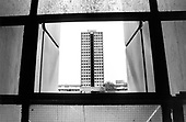 Hermes Point on Elgin Estate, North Paddington, seen through a broken window in its sister block Chantry Point. The asbestos-ridden towers were used by Westminster City Council to rehouse homeless families as part of the programme which became known as the 'Homes for Votes' scandal.  The towers were demolished in 1995.