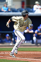 Vanderbilt Commodores infielder Penn Murfee (16) runs to first during a game against the Indiana State Sycamores on February 21, 2015 at Charlotte Sports Park in Port Charlotte, Florida.  Indiana State defeated Vanderbilt 8-1.  (Mike Janes/Four Seam Images)