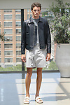 Model Eli poses in an outfit from the Deveaux Spring Summer 2017 collection on July 13 2016, during New York Fashion Week Men's Spring Summer 2017.