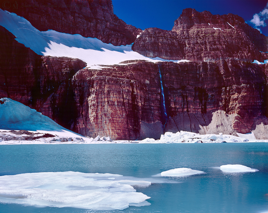 Iceburgs float in front of what remains of Grinnell Glacier.  Due to climatic changes, the glacier is predicted to be gone by 2030.  The Salamander Glacier sits on a shelf above Grinnell, but at one time, they were attached as one.  Someday I hope my Grandsons will be able to see and admire this place.