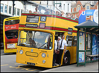 BNPS.co.uk (01202 558833)<br /> Pic:   RogerArbon/BNPS <br /> <br /> Conductor Martin Cuff and driver Nick Jackson wait to greet passengers getting on at Gervis Place in Bournemouth.<br /> <br /> A small group of volunteers have reintroduced a historic seaside bus service after spending five years restoring the original bus that travelled the route 50 years ago.<br /> <br /> The classic yellow open top 1965 Daimler Fleetline double decker is back running the old 'Route 12'  service between Bournemouth and Hengistbury Head.<br /> <br /> The volunteers drive and conduct the bus, as well as maintaining it and producing the timetables and bus stop flags.<br /> <br /> The vintage Bournemouth Corporation Transport bus ran along the idyllic five mile stretch of Dorset coastline from 1965 to 1977.<br /> <br /> But it had fallen into a 'sorry state' and was languishing in a depot when it was purchased by the volunteers from a bus operator in Purfleet, Essex, for £2,000 in 2014.