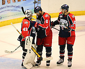December 30th, 2007:  Craig Kowalski (43), Dan Smith (6), and Jeffrey Szwez (23) of the Syracuse Crunch celebrate after the Syracuse Crunch shutout the Rochester Amerks 4-0 to earn the win at Blue Cross Arena at the War Memorial in Rochester, NY.  Photo Copyright Mike Janes Photography 2007.