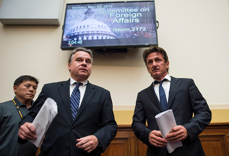 "UNITED STATES - MAY 20: Rep. Chris Smith, R-N.J., left, escorts actor Sean Penn, founder and CEO of the J/P Haitian Relief Organization, to the witness table for the House Foreign Affairs Committee TopicAfrica, Global Health, Global Human Rights and International Organizations Subcommittee hearing on ""Advocating for American Jacob Ostreicher's Freedom after Two Years in Bolivian Detention"" on Monday, May 20, 2013. (Photo by Bill Clark/CQ Roll Call)"