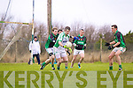 Eamonn O'Neill of Na Gaeil feels the pressure of Bobby Houlihan of Granagh/Ballingarry in the Muster Junior B Football Final last Sunday afternoon in Knockaderry.