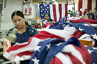 21 June 2005 - Oaks, PA - Virbala Patel (R) and Alirez Hashmi (L) assemble parts of American flags at the Annin & Co. flag manufacturing plant in Oaks, PA. Photo Credit: David Brabyn.