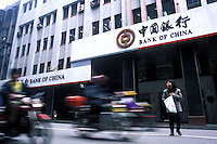 Traffic passes by a branch of the Bank of China in Guangzhou, China.