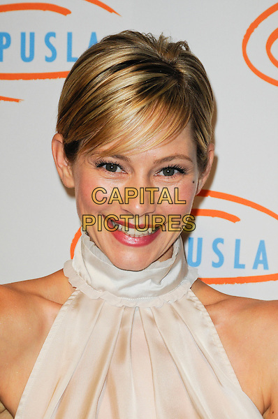 MEREDITH MONROE .arriving at Lupus LA's 7th Annual Bag Ladies Luncheon to raise funds for lupus research at the Beverly Wilshire Four Seasons Hotel in Beverly Hills, California, USA, .November 18th, 2009..portrait headshot white sleeveless high neck collar top lipstick make-up fringe smiling .CAP/ROT.©Lee Roth/Capital Pictures
