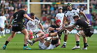 Northampton Saints's James Haskell hands off to with team-mate Teimana Harrison as he is tackled by Clermont Auvergne's Arthur Iturria<br /> <br /> Photographer Stephen White/CameraSport<br /> <br /> European Rugby Challenge Cup - Northampton Saints v Clermont Auvergne - Saturday 13th October 2018 - Franklin's Gardens - Northampton<br /> <br /> World Copyright © 2018 CameraSport. All rights reserved. 43 Linden Ave. Countesthorpe. Leicester. England. LE8 5PG - Tel: +44 (0) 116 277 4147 - admin@camerasport.com - www.camerasport.com