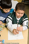 Education Elementary Public Grade 2 two boys in science class vertical