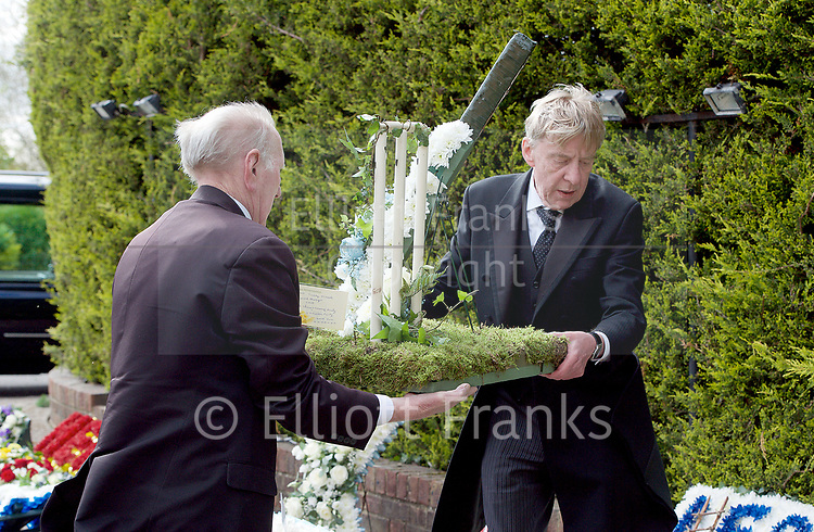 Leslie Rhodes funeral at North East Surrey Crematorium, Morden, Surrey, Great Britain 5th May 2017 <br /> <br /> undertakers laying out the floral tributes outside the crematorium <br /> <br /> Leslie Rhodes was one of the victims of the Westminster terror attack on 22nd March 2017. Mr Rhodes was Winston Churchill's former window cleaner.<br /> <br /> Leslie Rhodes, from south London, suffered serious injuries when terrorist Khalid Masood mowed down pedestrians on Westminster Bridge. The 75-year-old was rushed to King&rsquo;s College Hospital but died there when his life support was withdrawn at about 8.25pm the following day. <br /> <br /> He had been attending an appointment at St Thomas&rsquo;s Hospital before Masood went on a rampage &ndash; killing four and injuring 50 before he was shot dead by police.<br /> <br /> Mr Rhodes, who friends revealed was the former window cleaner of Winston Churchill, suffered broken ribs and a punctured lung in the attack.<br /> <br /> <br /> Photograph by Elliott Franks <br /> Image licensed to Elliott Franks Photography Services