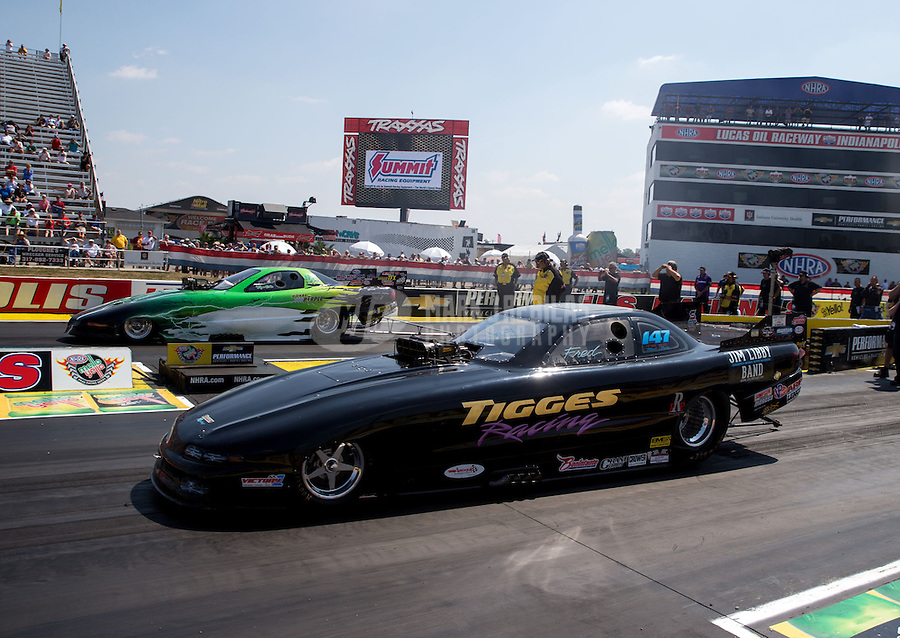 Aug. 30, 2013; Clermont, IN, USA: NHRA top alcohol funny car driver Fred Tigges during qualifying for the US Nationals at Lucas Oil Raceway. Mandatory Credit: Mark J. Rebilas-