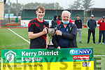 Park FC captain Earnan Ferris accepts the Denny Youths Cup from John O'Regan, Sec of the KDl after defeating Listowel Celtic on Saturda.