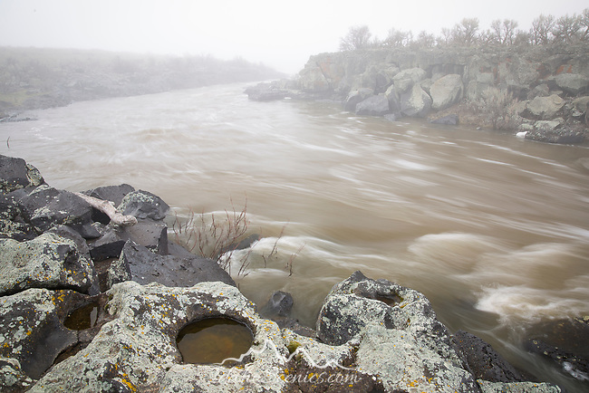 Idaho, South central, Shoshone. Spring runoff fills Balck Magic canyon to the brim with a muddy brown raging river.