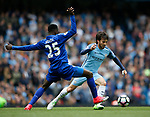 Wilfred Ndidi of Leicester City stretches to try and stop David Silva of Manchester City during the English Premier League match at the Etihad Stadium, Manchester. Picture date: May 13th 2017. Pic credit should read: Simon Bellis/Sportimage