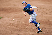 "Texas Rangers second baseman Ian Kinsler #5 charges and throws the ball to first during the MLB exhibition baseball game against the ""AAA"" Round Rock Express on April 2, 2012 at the Dell Diamond in Round Rock, Texas. The Rangers out-slugged the Express 10-8. (Andrew Woolley / Four Seam Images)."