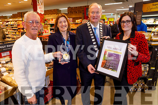 The presentation of the Gold Medal for the Supervalu Tidy Towns presented to the Tidy Tralee Together in Garveys Supervalu on Monday.<br />  L to r: Cllr: Sam Locke, Fiona Mullins (Chairperson Tralee Tidy Towns), Cllr Jim Finucane (Mayor of Tralee) and  Sandra Lynch (Garveys Supervalu)