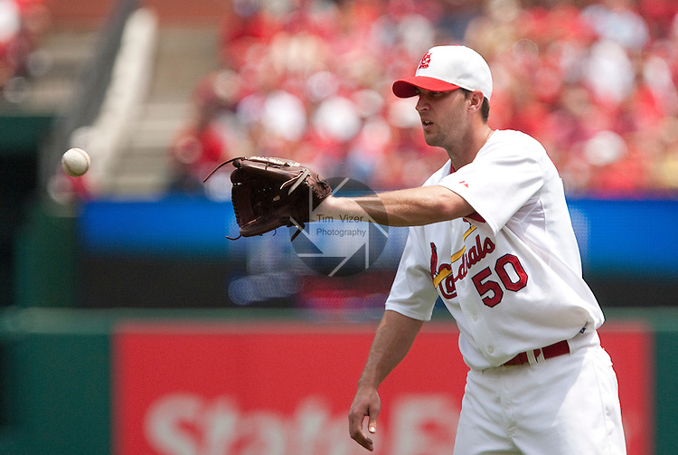 July 4, 2010          St. Louis Cardinals starting pitcher Adam Wainwright (50) catches the ball thrown back to him from the infield after striking out a Brewers player.  He was one of five Cardinals players selected to play in the All-Star Game.  The St. Louis Cardinals defeated the Milwaukee Brewers 7-1 in the final game of a four-game homestand at Busch Stadium in downtown St. Louis, MO on Sunday July 4, 2010.