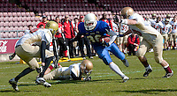 09 MAY 2010 - NORTHAMPTON, GBR - Birmingham Lions running back Sarunas Babonas weaves his way through the Loughborough Aces defence during the British Universities American Football Championship Final (PHOTO (C) NIGEL FARROW)