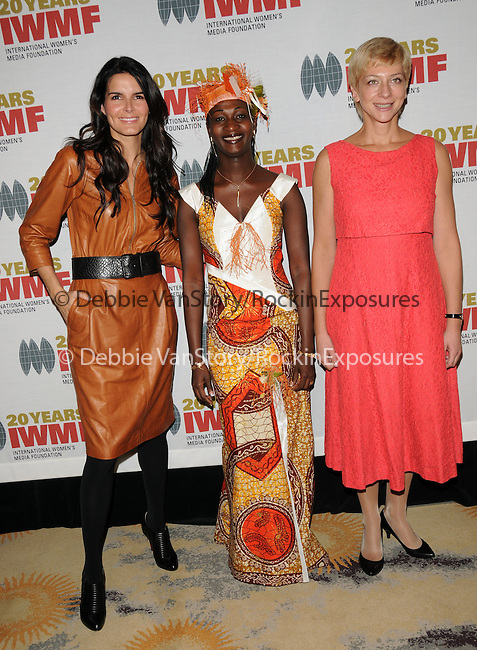 Angie Harmon,Agnes Taile & Iryna Khalip at The 2009 Courage in Journalism Awards held at The Beverly Hills Hotel in Beverly Hills, California on October 28,2009                                                                   Copyright 2009 DVS / RockinExposures