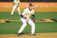 Wake Forest Demon Deacons shortstop Conor Keniry (14) on defense against the Marshall Thundering Herd at Wake Forest Baseball Park on February 17, 2014 in Winston-Salem, North Carolina.  The Demon Deacons defeated the Thundering Herd 4-3.  (Brian Westerholt/Four Seam Images)