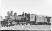 Fireman's-side view of D&amp;RGW locomotive #302 dead in storage at Alamosa with parts missing.<br /> D&amp;RGW  Alamosa, CO  Taken by Perry, Otto C. - 7/4/1938