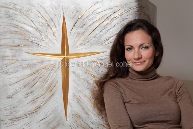 Artist Fleur Nabert posing near the altar, Chapelle Notre Dame du sourire (Chapel of our smiling lady), Ermitage Sainte-Therese, Lisieux, Normandy, France. The chapel was consecrated in December 2012 by Mgr Boulanger, bishop of Bayeux and Lisieux, after being restored and furnished by sculptor Fleur Nabert. Picture by Manuel Cohen - This picture requires further clearance from the author Fleur Nabert / Autorisation necessaire aupres de l'artiste Fleur Nabert.