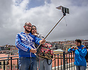 Lisbon, UK. 04.05.2015. People take selfies at a high point, by Zambeze restaurant, at the top of a Pingo Doce supermarket. © Jane Hobson,