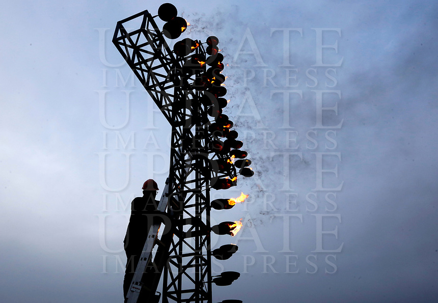 A worker lights the cross ahead of the Via Crucis (Way of the Cross) on Good Friday, presided by the Pope in front of the Colosseum in Rome, March 30, 2018.<br /> UPDATE IMAGES PRESS/Riccardo De Luca<br /> <br /> STRICTLY ONLY FOR EDITORIAL USE
