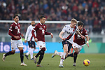 Jerdy Schouten of Bologna takes on Simone Verdi and Alejandro Berenguer of Torino FC as Sasa Lukic of Torino FC looks on during the Serie A match at Stadio Grande Torino, Turin. Picture date: 12th January 2020. Picture credit should read: Jonathan Moscrop/Sportimage