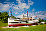 The Historic Landmark Lake Champlain paddle steamship TICONDEROGA operated as a ferry between 1906 and 1950. Immaculately restored, the TICONDEROGA sits like a giant toy boat on a green lawn at the Shelburne Museum south of Burlington, Vermont.