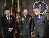 Fort Meade, MD - October 24, 2008 -- United States President George W. Bush (R), accompanied by Vice President Dick Cheney (L) and NSA Director Lt. Gen. Keith B. Alexander, speaks to reporters after attending a closed door intelligence briefing at the National Security Agency in Fort Meade, Maryland on October 24, 2008. <br /> Credit: Yuri Gripas / Pool via CNP