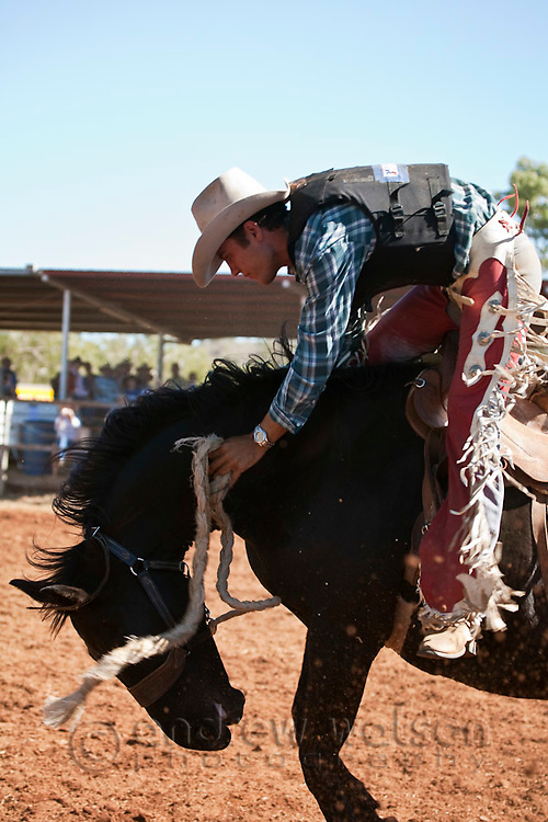 Saddle bronc competitor in action at Chillagoe Rodeo.  Chillagoe, Queensland, Australia