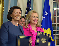 December 14, 2011  (Washington, DC)  After signing a cultural heritage preservation agreement at the Department of State, U.S. Secretary of State Hillary Clinton and the President of Kosovo, Atifete Jahjaga (left), pose for a photos.    (Photo by Don Baxter/Media Images International)