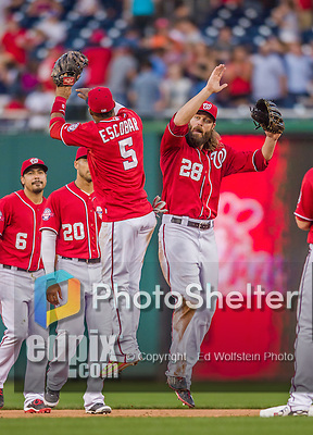 19 September 2015: Washington Nationals outfielder Jayson Werth (28) jumps up to celebrate with Yunel Escobar after a game against the Miami Marlins at Nationals Park in Washington, DC. The Nationals defeated the Marlins 5-2 in the third game of their 4-game series. Mandatory Credit: Ed Wolfstein Photo *** RAW (NEF) Image File Available ***