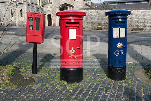 Windsor, England. Red postage stamp machine and post box marked EIIR, old blue airmail pillar box marked GR, Coronation Aerial post King George V.