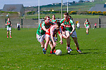 Waterville's Sam O'Dwyer gets possession and earns a free as St Michaels/Foilmore's Colin Grandfield and Vinny Casey apply pressure at the South Kerry League Final in the Con Keating Park, Cahersiveen on Saturday.