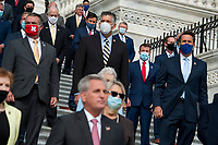 """GOP members of Congress listen as United States House Minority Leader Kevin McCarthy (Republican of California), and United States House Minority Whip Steve Scalise (Republican of Louisiana) and hold a press conference regarding the """"Commitment to America: to restore our way of life, rebuild the greatest economy, and renew the American dream"""" on the House Steps at the US Capitol in Washington, DC., Tuesday, September 15, 2020. <br /> Credit: Rod Lamkey / CNP /MediaPunch"""