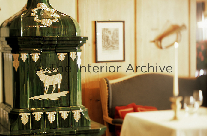 A detail of a pottery piece featureing a deer in the dining room of the Hotel & Spa Rosa Alpina