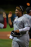 Peoria Javelinas first baseman Josh Naylor (20), of the San Diego Padres organization, receives high fives from teammates after recording the final out of an Arizona Fall League game against the Scottsdale Scorpions on October 20, 2017 at Scottsdale Stadium in Scottsdale, Arizona. the Javelinas defeated the Scorpions 2-0. (Zachary Lucy/Four Seam Images)