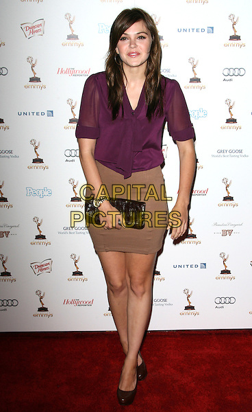 Aimee Teegarden.63rd Annual Primetime Emmy Awards Cocktail Reception Honoring Nominees for Outstanding Performances held at Spectra by Wolfgang Puck inside the Pacific Design Center, Los Angeles, California, USA, September 17th 2011..full length  purple sheer top blouse  beige skirt clutch bag shoes .CAP/ADM.©AdMedia/Capital Pictures.