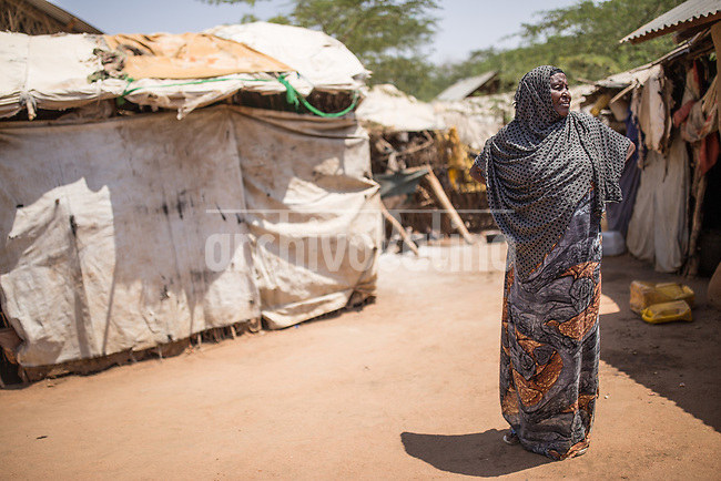 Woman at the refugee camp of Daadab in Kenya, with a population estimated in 250,000 people. Created in 1992 to host people escaping the civil conflict in Somalia, the camp under the custody of United Nations grew with waves of people escaping from civil wars and droughts. Generations are born, grown and died in this camp, considered the second largest of the World
