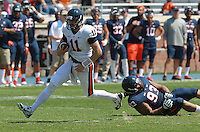 Virginia quarterback Greyson Lambert (11) runs past Virginia defensive tackle Donte Wilkins (93) during the annual Virginia football Orange-Blue Spring Game Saturday at Scott Stadium in Charlottesville, VA. Photo/The Daily Progress/Andrew Shurtleff